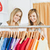 Joyful female friends choosing colorful shirts in a clothes store stock photo © wavebreak_media