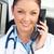 sonriendo · femenino · médico · hablar · teléfono · oficina - foto stock © wavebreak_media