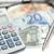 money pen glasses and angled pocket calculator on a white background stock photo © wavebreak_media