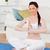 mujer · atractiva · yoga · gimnasio · alfombra · salón · casa - foto stock © wavebreak_media