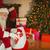 улыбаясь · Дед · Мороз · чулок · подарки · домой · гостиной - Сток-фото © wavebreak_media