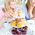 Portrait of two smiling female friends eating pastries in the kitchen at home stock photo © wavebreak_media