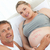 future father touching his wifes belly at home stock photo © wavebreak_media