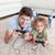 famille · heureuse · jouer · jeux · vidéo · ensemble · salon · maison - photo stock © wavebreak_media