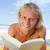 sonriendo · hombre · lectura · libro · playa - foto stock © wavebreak_media