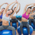sporty women stretching up hands on exercise balls at gym stock photo © wavebreak_media