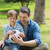 father and son sitting with ball at park stock photo © wavebreak_media