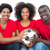 happy football fans in red holding ball together stock photo © wavebreak_media