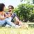 souriant · belle · couple · séance · été · parc - photo stock © wavebreak_media
