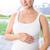 terhes · nő · tart · dudorodás · otthon · konyha · boldog - stock fotó © wavebreak_media