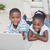 родителей · смотрят · детей · используя · ноутбук · счастливым · гостиной - Сток-фото © wavebreak_media