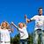 glimlachend · kaukasisch · familie · spelen · tuin · blauwe · hemel - stockfoto © wavebreak_media
