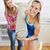 Delighted women holding a carpet standing in the kitchen after moving stock photo © wavebreak_media