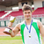 Delighted male athlete holding a cup and a medal standing in a stadium stock photo © wavebreak_media