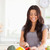 Good looking woman cooking vegetables while standing in the kitchen stock photo © wavebreak_media