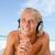 sonriendo · hombre · escuchar · música · auricular · manos - foto stock © wavebreak_media