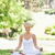 souriant · jeune · femme · séance · yoga · poste · parc - photo stock © wavebreak_media