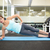 fit brunette doing pilates on exercise mat stock photo © wavebreak_media