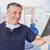 smiling dentist examining a x ray stock photo © wavebreak_media