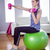 fit woman lifting dumbbells on exercise ball stock photo © wavebreak_media