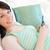 mosolyog · női · tinédzser · kanapé · ír · üzenetek - stock fotó © wavebreak_media