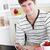 giovane · utilizzando · il · computer · portatile · colazione · seduta · cucina · sorridere - foto d'archivio © wavebreak_media