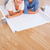portrait of a couple with cups of coffee and a plan while lying on the floor stock photo © wavebreak_media