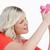 kobieta · różowy · banku · piggy · biały · ręce · piękna - zdjęcia stock © wavebreak_media