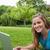 szczęśliwy · student · parku · za · pomocą · laptopa · patrząc - zdjęcia stock © wavebreak_media