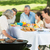 barbecue grill with extended family having lunch in park stock photo © wavebreak_media