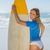 blonde smiling surfer holding her board on the beach stock photo © wavebreak_media