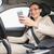 nő · vezetés · autó · gépel · szöveges · üzenet · mobil - stock fotó © wavebreak_media