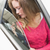 young woman holding seat belt stock photo © wavebreak_media