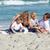 özenli · ebeveyn · çocuklar · oturma · kum · plaj - stok fotoğraf © wavebreak_media