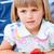 Cute little girl eating waffles with strawberries stock photo © wavebreak_media