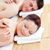 positive young couple receiving a back massage in a spa center stock photo © wavebreak_media