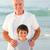 grand-père · petit-fils · plage · famille · coucher · du · soleil · mer - photo stock © wavebreak_media