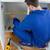 Young repair man measuring something in a kitchen stock photo © wavebreak_media