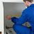Portrait of a handyman measuring something in a kitchen stock photo © wavebreak_media