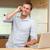 mosolyog · férfi · laptop · mobiltelefon · konyha · számítógép - stock fotó © wavebreak_media