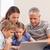 счастливая · семья · сидят · диван · ноутбук · гостиной · семьи - Сток-фото © wavebreak_media