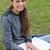 lächelnd · schriftlich · Notebook · Sitzung · Gras - stock foto © wavebreak_media