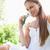 glimlachend · jonge · vrouw · park · bloem · schoonheid · zomer - stockfoto © wavebreak_media