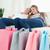 улыбаясь · пару · девочек · сидят · диване · посмотреть - Сток-фото © wavebreak_media