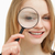 woman placing a magnifying glass on her eye stock photo © wavebreak_media