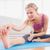 toned blonde stretching on exercise mat stock photo © wavebreak_media