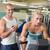 uśmiechnięta · kobieta · mężczyzna · trener · siłowni · sportu - zdjęcia stock © wavebreak_media