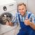 férfi · javít · mosógép · fiatalember · átfogó · ház - stock fotó © wavebreak_media