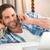 boldog · férfi · okostelefon · ágy · jóképű · fiatalember - stock fotó © wavebreak_media