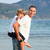 father giving son piggyback ride on the beach stock photo © wavebreak_media